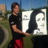 SINGER STOKES NIELSON WITH PAINTING OF HIS NEW ALBUM COVER